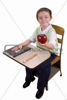 Boy at school desk