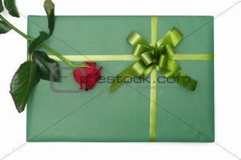Green gift with red rose