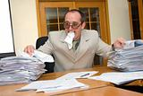 Businessman eating the work