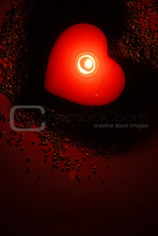 A romantic candle in red fascinating light.