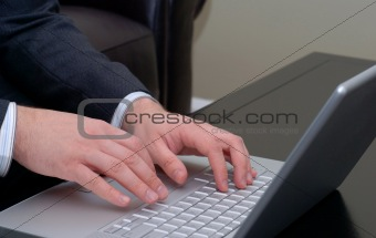 Business Hands with Silver Laptop