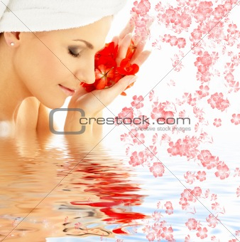 lady with red petals and flowers in water