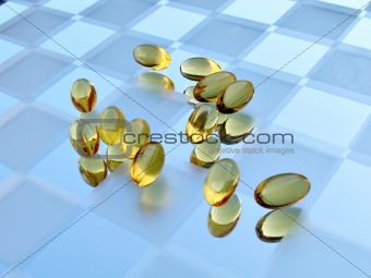 Close up shot of medicine capsules on glass surface