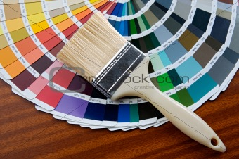 Paintbrush with card of colors
