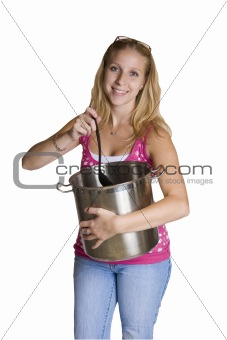 A beautiful young lady stirring a pot