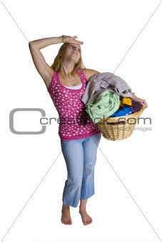 A beautiful young lady overwhelmed by too much laundry