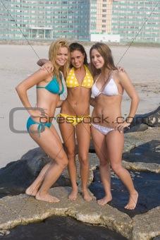 Beautiful girls on the beach all in bikinis