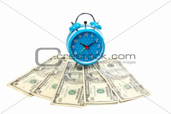 Alarm clock over a fan of money