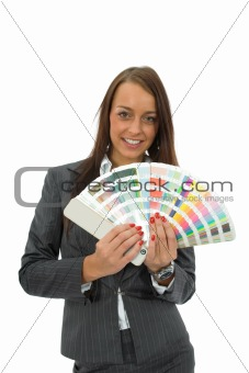 Business woman demonstrates palette of the paints