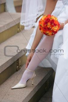 Bride Adjusting her wedding shoes