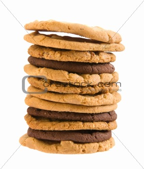 high stack of different types of cookies ; isolated on white background;