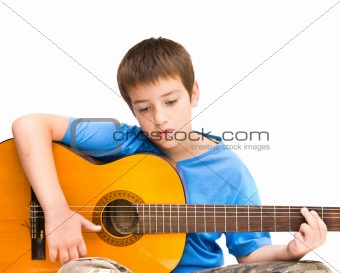caucasian boy learning to play acoustic guitar; isolated on white background; horizontal crop