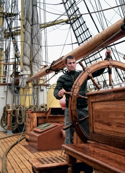 man at the helm