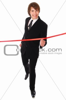 teenage businessman is running through the red line.