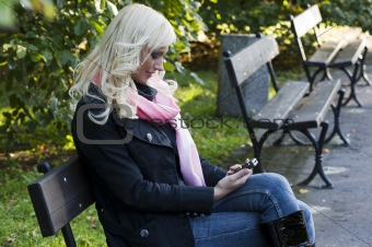 sitting in a bench with mobile