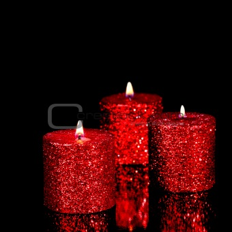 Three spangled candles in the dark
