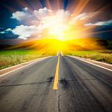 sunlight above the road.