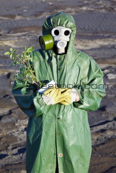 Scientific Environmentalist gently hugs a plant