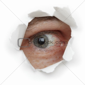 Eye of person in hole close up