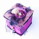 Purple gift box with a rose isolated.