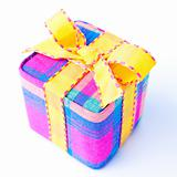 Colorful striped gift box isolated.