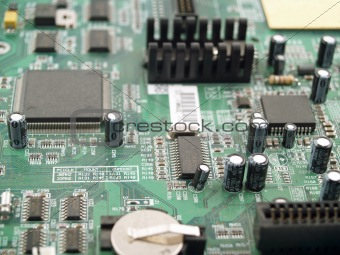 Circuit Board Closeup Showing Chips and Transisters