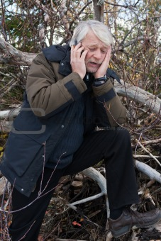 Mature middle-aged man in forest.