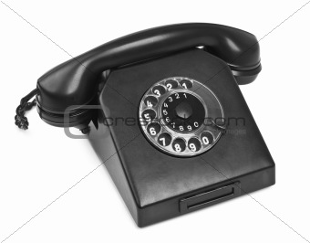 old bakelite telephone on white
