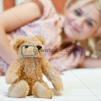 Beautiful young girl with toy