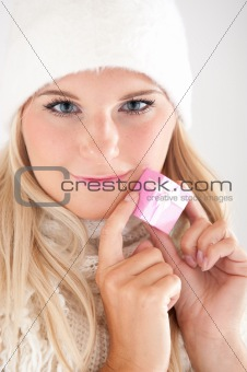 beautiful winter woman in warm casual clothes with little christmas present