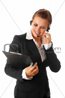 smiling modern business woman with headset and clipboard