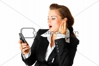 Business woman with earphone listening music on mobile phone