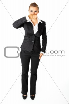 Full length portrait of  modern business woman with hand on mouth