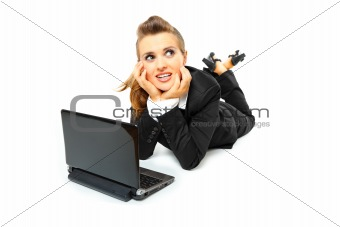 Dreaming  modern business woman using laptop on floor