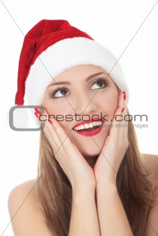 Beautiful young woman in red wearing santa hat. Isolated on whit