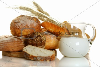 Fresh bread and milk in a glass jar.