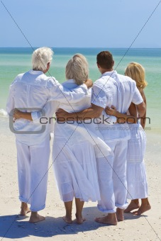 Two Couples Generations of Family Embracing on Tropical Beach