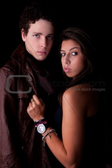 a beauty and cute couple, isolated on black, studio shot