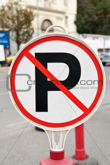 A no parking sign next to a road