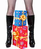Girl legs with presents