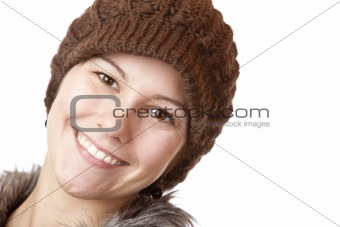 Beautiful girl with cap smiles happy