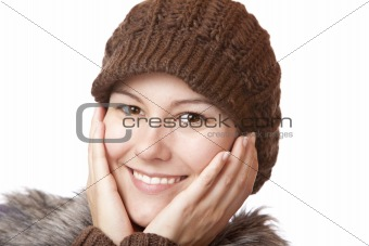 Beautiful woman with hands on face  smiles happy