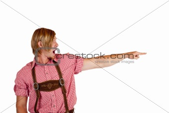 Bavarian man with oktoberfest leather trousers pointing with finger at copy-space