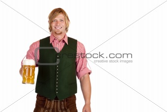 Bavarian man with leather trousers (lederhose) holds oktoberfest beer stein in hand