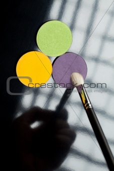 a 3 eye shadow and one eye shadow brush composition