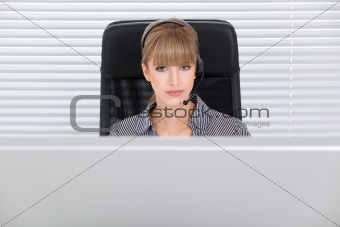 Beautiful secretary portrait in a clean high tech office