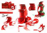 Different sizes of red ribbons and gift wrapped boxes on white