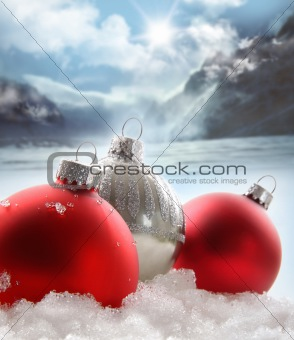 Three red christmas balls in the snow