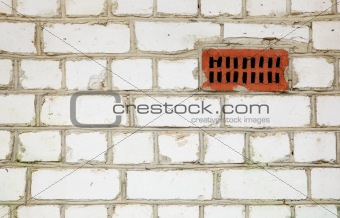 Brick wall with primitive ventilation