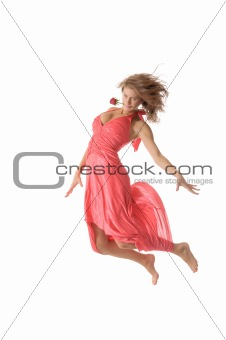 Beautiful young woman with flower jumps